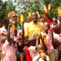 Seen here with some of the children in the Springs of Hope school.
