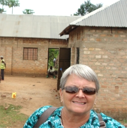 Jenny Tryhane one of the Trustees of ABCD flew in from Barbados to visit the land with the ten room warehouse on site.