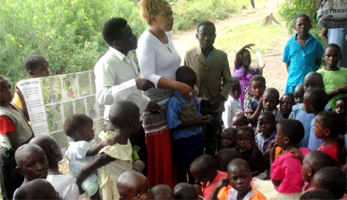 Lisa planting the Jesus seed in child evangelism on the mountain at Nyangrongo Full Gospel church