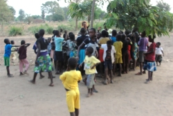 Meanwhile Lisa did child evangelism with the children from the village under the tree, African style!