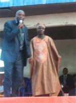 Pastor Abraham seen here with his spiritual father, Apostle Pinos on stage.