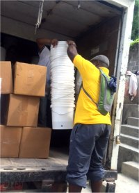 Fitlers seen arriving in St Marc prior to the distribution by our United Caribbean Trust team.