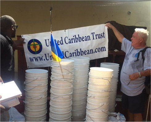 Haiti Mission trip Jeremie Methodist church water filter distribution to help survivors of Hurricane Matthew in Haiti with Sawyer filtered clean water as fears of an increase in cholera cases grow