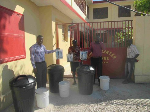 United Caribbean Trust Sawyer school distribution to help survivors of Hurricane Matthew in Haiti with Sawyer filtered clean water