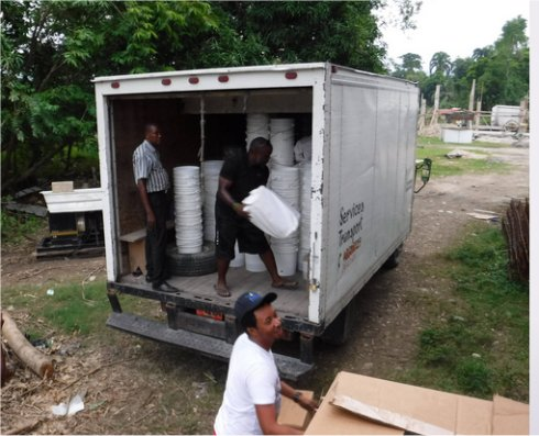 Haiti Mission trip Les Cayes water filter distribution to help survivors of Hurricane Matthew in Haiti with Sawyer filtered clean water as fears of an increase in cholera cases grow