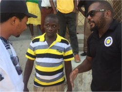 The leader in Jeremie receiving information from Imran being translated by a member of the Haitian team.