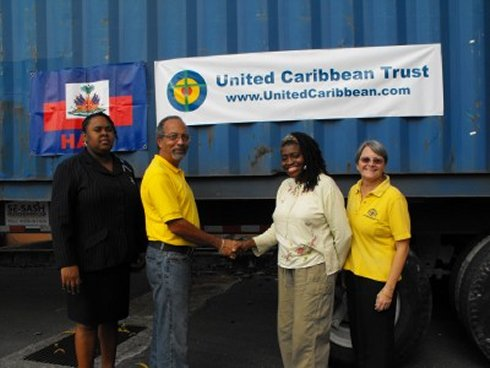 United Caribbean Trust founder Jenny Tryhane and Greta St Hill receive the container for Haiti following the earthquake