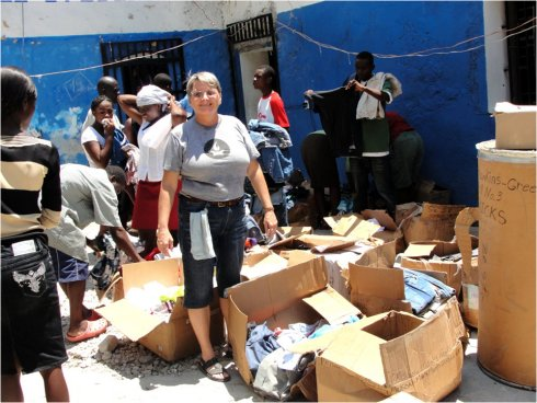 United Caribbean Trust founder Jenny Tryhane in Haiti following the earthquake delivering relief supplies to the prison