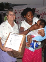 Jenny Tryhane, Founder of UCT in Haiti distributing a box in one of the tent cities.