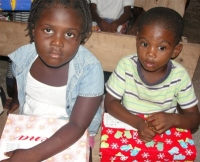 Children from a small Haitian church receiving thier Make Jesus Smile shoeboxes.
