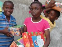 The Make Jesus Smile shoebox distribution took place outdoors at the Church of God school in Les Cayes.