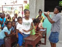 The children of the Church of God school in Les Cayes received their Make Jesus Smile shoeboxes
