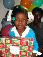 At last Pastor Banes was able to deliver the Make Jesus Smile shoeboxes to the children at his church.