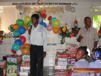 The children of Church of God of Prophecy Port Salut receive their Make Jesus Smile shoeboxes