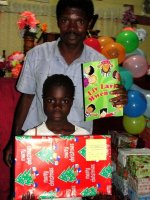 Seen here one of your boxes being delivered to a child in Les Martineur Church of God.