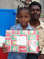 Seen here one of the Fitz Village Make Jesus Smile shoeboxes being delivered to a Church of God school in Les Cayes we were able to donate a Sawyer PointOne Community Water Filter Unit donated by Special Treasures in London, England.