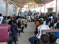 The church in the YWAM base was packed with excited children as we began the 2010 Make Jesus Smile shoebox distribution