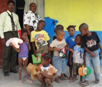 Children of Bethesda earthquakedisaster orphanage receiving their Sawyer Filter Community Unit