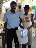 Pastor Pierre Banes Laurore, the Kids' EE Haiti Director seen here in YWAM in Gonaive documenting the Sawyer PointONE water filter distribution.