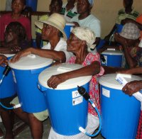 Seen here some of the residence of Cite Soleil receiving their filters immediately after the earthquake.l