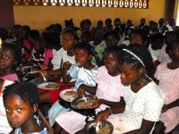Haiti Church of God feeding the children at the Kids EE Training Summer Camp