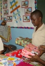 Make Jesus Smile shoeboxes being filled by a Barbadian school boy