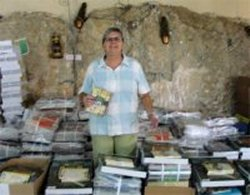 Jenny Tryhane founder of United Caribbean Trust unpacking Love Packages donated to Mount Zion Missin International church