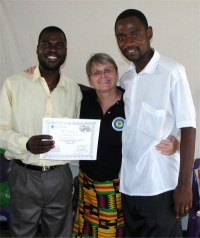 Pastor David, right Jenny and and Pastor Mango, left the Uliwa KIMI teacher receiving his KIMI certificate
