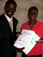 Seen here receiving her KIMI curriculum and Manual from Pastor William the Uilwa KIMI Coordinator.