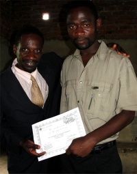 Seen here with Pastor David receiving his KIMI certificate at the KIMI Leadership Training in Uluwa in Malawi.