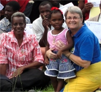 Pastor Enid seen here with Jenny and her little girl Loveness.