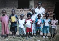 Teacher Steria Chawawa with standard 2 pupil orphans at the  Chisomo Christian Orphan school