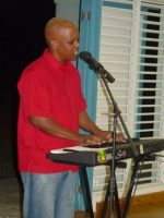 David Rowe leading praise and worship at St Gabrials School Barbados