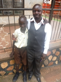 Jonathan seen here with his new dad - Pastor Abraham on his first day at school - praise God.
