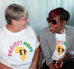 Seen here at the Project Hope Launch at Limegrove having a laugh with Jenny Tryhane, founder of United Caribbean Trust...