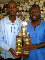Pastor Lafleur and Pastor Rodrigue from Restoration Ministries Haiti with the winning trophy.