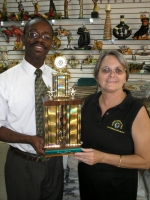 Jenny Tryhane, Founder of United Caribbean Trust with the Manager of Sewing World with the winning trophy
