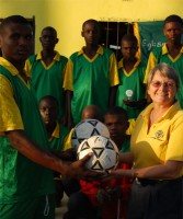 Haiti football team receiving their new footballs
