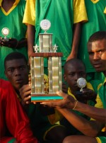 Football the champions in Hati with their trophy donated by Sewing World Barbados