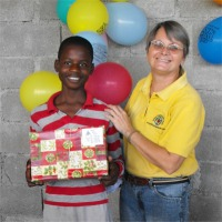 Seen here Jenny Tryhane, the Founder of United Caribbean Trust distributing the Make Jesus Smile shoeboxes at Upper Room Orphanage.