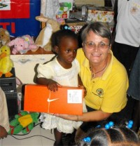 Jenny Tryhane, Founder of United Caribbean Trust giving out the first shoeboxes only hours after the container had been released.