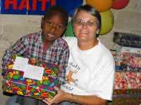 Jenny Tryhane distributing the Make Jesus Smile shoeboxes