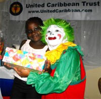 A child in Haiti receiving a Make Jesus Smile shoebox wrapped and packed by a child at Hawthorne Methodist Church.