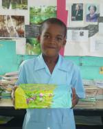 Barbadian school children packing  shoe boxes for the children on the Caribbean