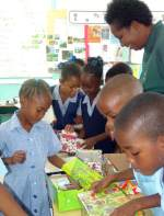 Barbados school packing shoeboxes in the Make Jesus Smile programme