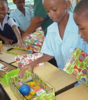 Half Moon Primary School children in Barbados with their boxes packed ready for shipping to Haiti