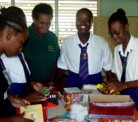 St Lucy Secondary school seniors pack gifts for children in the Caribbean