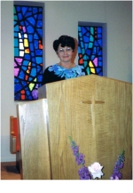 Peggy giving her testimony in the chapel