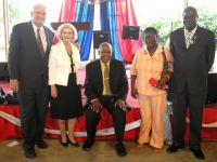 Seen here with Apostle James Cooper and his wife and the covering Apostle. Click to enlarge.