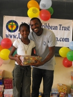 mran  Richards distributing the Make Jesus Smile shoeboxes in Brokoponda